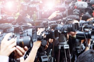 press and media camera ,video photographer on duty in public news event for reporter